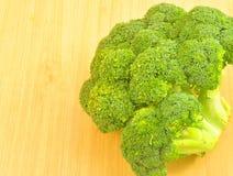 Brocoli. A head of fresh brocoli on a table stock photos