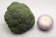 Brocoli. Broccoli and onion with a light blackground stock images