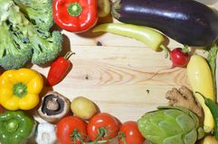 Veggies on wooden board royalty free stock image