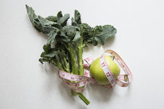 Brocolli and apple diet Royalty Free Stock Photos