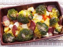 Brocolli e casseruola della patata Fotografia Stock