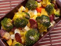 Brocolli och potatiseldfast form Royaltyfri Bild