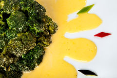 Brocolli with sauce Hollandaise Stock Images