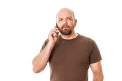 Brodaty mężczyzna przy telefonem Obrazy Stock