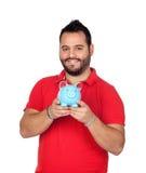Brodaty mężczyzna trzyma błękitnego prosiątko banka Obraz Stock