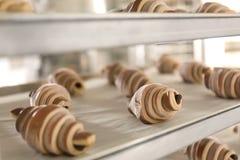 Broden van brood bij het opschorten Royalty-vrije Stock Afbeeldingen