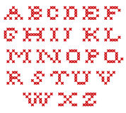 Broderat alfabet Arkivfoto