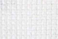 Broderi för vit tråd för modell för broderi för makroskottfragment handgjord, modell i korsstygnstil på vitt tyg Royaltyfri Fotografi