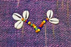 Broderie avec des perles, et coquilles Images libres de droits