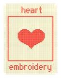Broderie avec le coeur et la trame Photographie stock