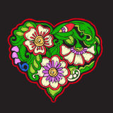Broderie avec le coeur modelé d'amour sur le fond noir Photo libre de droits