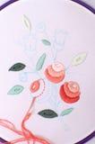 Broderie avec le motif floral encadrée dans un cercle Travail dans le procédé Image libre de droits