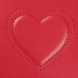 Broderie dans la forme de deux coeurs sur le cuir rose, lumière latérale Photos stock