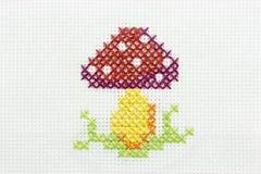 Broderie de l'image d'un champignon de couche Photo libre de droits