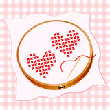 Broderie rouge de deux coeurs Image stock