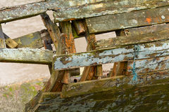 Broekn wooden hull of ship with flaking paint Stock Image