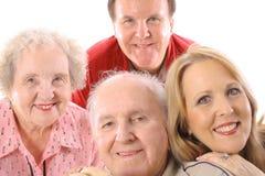 Broer & zuster met bejaarde ouders Stock Foto's