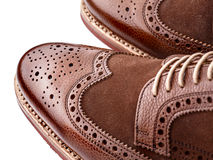 Brogue toe. Unworn, laced pair of handcrafted shiny, two tone men brogues (also known as derbys, gibsons or wingtips). The upper is stunning combination of brown Stock Photography