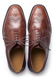 Brogues from above. A pair of men's traditional brown shoes isolated on white and shot from above Stock Photography