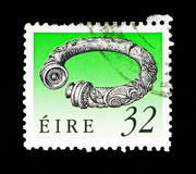Broighter Collar (1st Cty. BC), Irish Heritage and Treasures 199. MOSCOW, RUSSIA - MAY 13, 2018: A stamp printed in Ireland shows Broighter Collar &# Royalty Free Stock Images