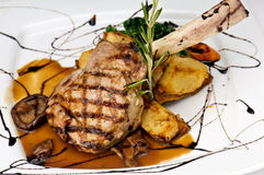 Broiled center cut veal chop. With sauteed onions and mushrooms stock photo
