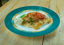 Broiled Cod. With Sun-Dried Tomatoes royalty free stock image