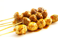 Broiled meatball pour with syrup Royalty Free Stock Images
