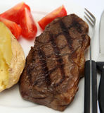 Broiled New York steak and veg Royalty Free Stock Photos