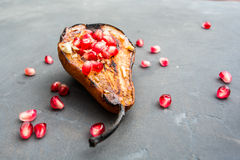 Broiled pear pomegranate dessert Royalty Free Stock Photos