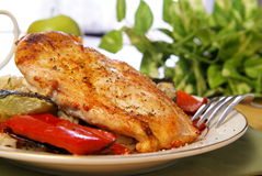 Broiled Pepper Chicken. Broiled chicken breast with cayenne and cracked black pepper, served with zucchini, red bell peppers, and wild brown rice royalty free stock photos