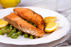 Broiled Salmon and Asparagus. Broiled Salmon, Asparagus and Lemon stock photos