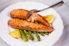 Broiled Salmon and Asparagus. Broiled Salmon, Asparagus and Lemon stock images