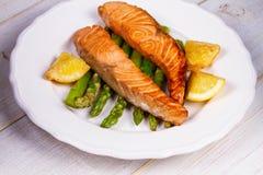 Broiled Salmon and Asparagus. Broiled Salmon, Asparagus and Lemon stock photo