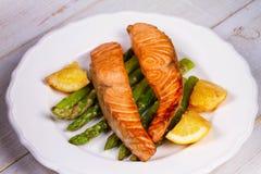 Broiled Salmon and Asparagus. Broiled Salmon, Asparagus and Lemon stock photography