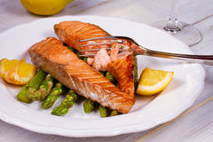 Broiled Salmon with Asparagus and Lemon. stock photography