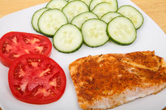Broiled Salmon with Sliced Tomatoes and Cucumbers Royalty Free Stock Images