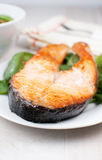 Broiled salmon steak. On plate vertical stock photos