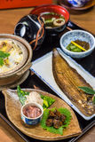 Broiled sole fish and boiled loaches with egg and burdock. Luxurious Japanese meal set - broiled sole fish and boiled loaches with egg and burdock royalty free stock photos
