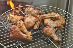 Broiler legs on grille Stock Photography