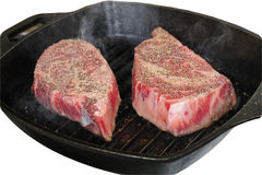 Broiling steak Stock Photography