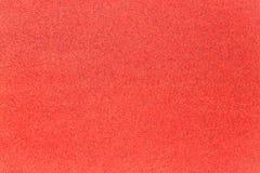 Brokaat glanzende rode achtergrond stock afbeelding
