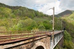 brokanjon över järnväg romania Royaltyfria Bilder