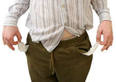 Broke. An unkempt man with no money left in his trouser pockets Stock Photography