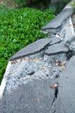 Broke Asphalt Road near canal Royalty Free Stock Image
