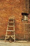 Broke brick wall ladder in different pose Royalty Free Stock Photography