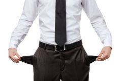 Broke business man with empty pockets Royalty Free Stock Images