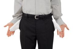 Broke businessman. Shows his empty pockets, isolated on white royalty free stock image