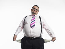 Broke Businessman Against White Background Royalty Free Stock Image