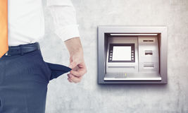 Broke businessman near ATM machine Royalty Free Stock Images