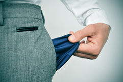 Broke businessman. A broke businessman showing his empty pocket Stock Photography